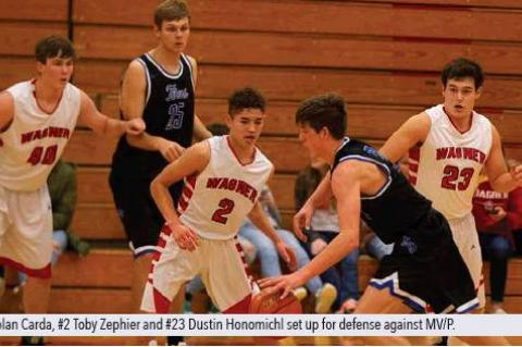 #40 Nolan Carda, #2 Toby Zephier and #23 Dustin Honomichl set up for defense against MV/P  .