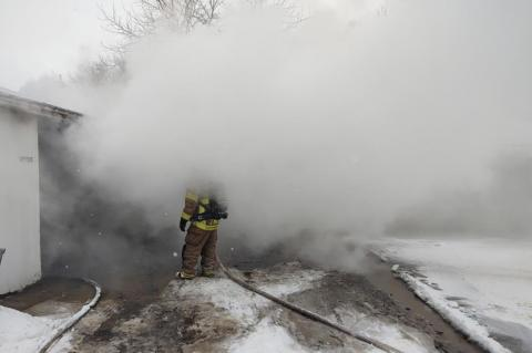 FIREMEN BRAVE THE COLD TO FIGHT MOTEL FIRE