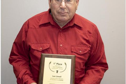 LINNELL EARNS 1ST PLACE IN NATIONAL WHEAT YIELD CONTEST
