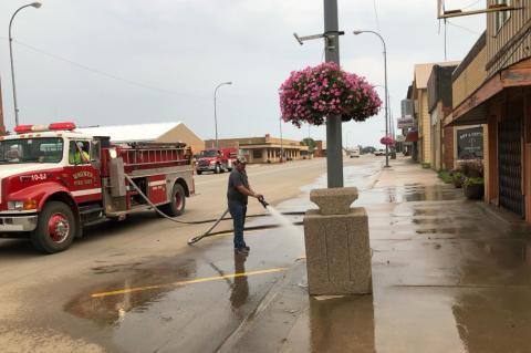 FIRE DEPARTMENT CLEANS MAIN STREET