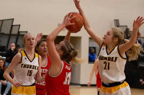 Josie Brouwer stops the shot attempt as Lexie VanderPol moves in to assist. Photos by Barb Pechous